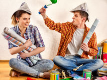 Repair family by happy couple building home . Quarrel family . Stock Photos