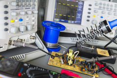 Repair faulty pulse source and checking. Using an oscilloscope Royalty Free Stock Photos