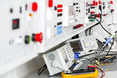 Repair faulty pulse source using an oscilloscope. And multimeter Royalty Free Stock Photo