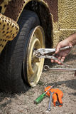 Repair flat tire Royalty Free Stock Images