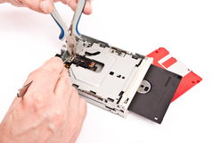 Repair of floppy disk drive. On white Stock Photo