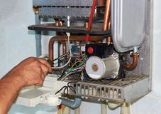 Repair of a gas boiler, setting up and servicing by a service department.  stock photography