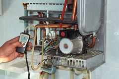 Repair of a gas boiler, setting up and servicing by a service department royalty free stock photography