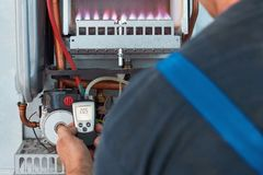 Repair of a gas boiler, setting up and servicing by a service department stock photos
