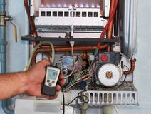 Repair of a gas boiler, setting up and servicing by a service department stock images