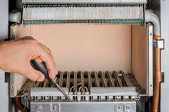 Repair gas burner boiler heating.  royalty free stock photo