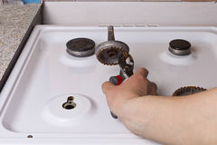 Repair gas stove Royalty Free Stock Image