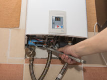 Repair of the gas water heater Stock Photography