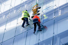 Repair on a glass facade Royalty Free Stock Images