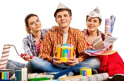 Repair group of people building home using paint roller tools. Royalty Free Stock Image