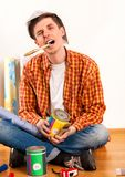 Repair home man holding paint roller for wallpaper. stock photography