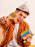 Repair home man holding paint roller for wallpaper. Stock Image