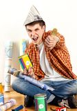 Repair home man holding paint roller for wallpaper. stock photos