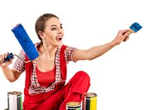 Repair home woman holding paint roller for wallpaper. Aggressive screaming girl in newspaper cap renovation apartment on isolated. Tired of work as a student stock images