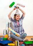 Repair home woman holding paint roller for wallpaper. Royalty Free Stock Image