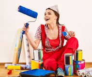 Repair home woman holding paint roller for wallpaper. Aggressive screaming girl in newspaper cap renovation apartment on isolated. Tired of work as student stock images