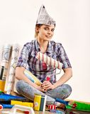 Repair home woman holding paint roller for wallpaper. Stock Photo