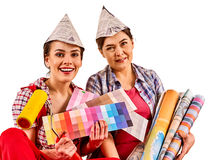 Repair home women holding Bank with paint for wallpaper. Stock Photos