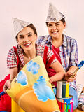 Repair home women holding Bank with paint for wallpaper. Stock Photography