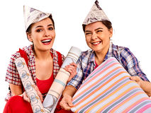 Repair home women holding Bank with paint for wallpaper. Royalty Free Stock Photography