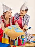 Repair home women holding Bank with paint for wallpaper. Repair home women holding color guide for wallpaper. Elderly mother and young daughter renovation royalty free stock photography