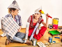 Repair home women holding color guide for wallpaper. royalty free stock image