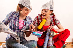 Repair home women holding painting tools roller for wallpaper. Stock Images