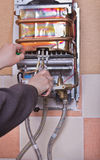 Repair of household water heater Stock Photography