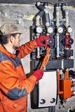 Repair of hydraulic heating system in the house. Plumber worker repairs the heating system in the house stock image
