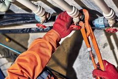 Repair of hydraulic heating system in the house. Plumber worker repairs the heating system in the house royalty free stock photos