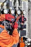 Repair of hydraulic heating system in the house. Plumber worker repairs the heating system in the house stock photography