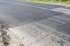 Repair and install old asphalt road with cracks. stock images