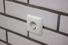 Repair, installation of sockets in the wall. finishing work in the finish. building material stock photo