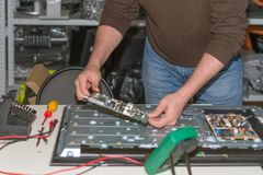 Repair LCD TV. The engineer parses the TV for diagnosis royalty free stock photography