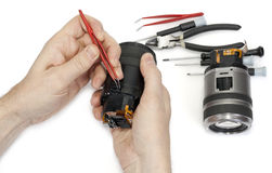 Repair of a lens of the digital  camera Royalty Free Stock Photography