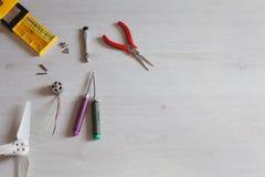 Repair maintenance drone, screws, screwdriver, tools, propellers. Repair maintenance drone, screws, screwdriver, tools Royalty Free Stock Images