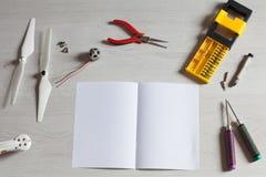 Repair maintenance drone, screws, screwdriver, tools, propellers. Repair maintenance drone, screws, screwdriver, tools Royalty Free Stock Image