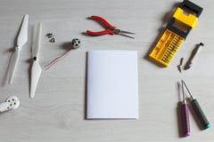Repair maintenance drone, screws, screwdriver, tools, propellers. Repair maintenance drone, screws, screwdriver, tools Stock Photos