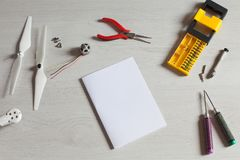 Repair maintenance drone, screws, screwdriver, tools, propellers. Repair maintenance drone, screws, screwdriver, tools Stock Images