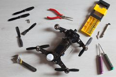 Repair maintenance drone, screws, screwdriver, tools, propellers. Yellow, red, green Royalty Free Stock Photography