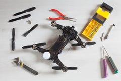 Repair maintenance drone, screws, screwdriver, tools, propellers. Yellow, red, green Royalty Free Stock Image