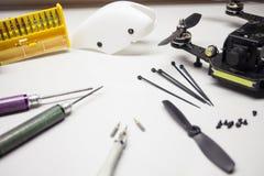 Repair maintenance drone, screws, screwdrivers, battery clamps. Tools Royalty Free Stock Images