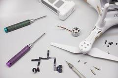 Repair maintenance drone, screws, screwdrivers, battery clamps Royalty Free Stock Photo