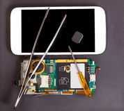 Repair and maintenance of mobile devices Stock Image