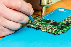 Repair and maintenance of office equipment, repair of the mother stock photos