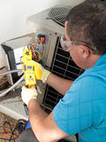 Repair man. Male hispanic air-conditioning maintenance technician Royalty Free Stock Images