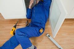 Repair man fixing something Royalty Free Stock Photo