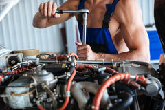 Repair man hands fixing engine on a plane Stock Image