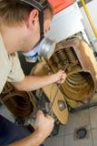 Repair man servicing gas boiler Royalty Free Stock Images