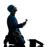 Repair man worker despair praying silhouette Stock Photos